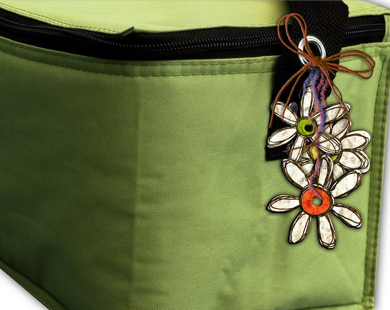Pretty retro flowers are what I hang on my personal lunch bag.  This makes me smile every time I use it!  - Kelly