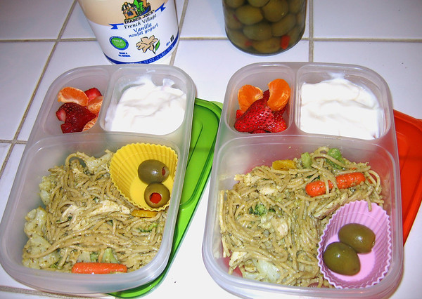Visit my blogto find out how you can bring yogurt in an EasyLunchbox container, leak free :) Here, it's served with a pesto linguini, fruit and a couple of olives for fun.