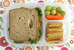 Sandwich (peppered turkey, havarti cheese, lettuce and mustard on whole grain bread), baby carrots and green grapes and SunChips. Photo credit: The wonderful Melissa  - Another Lunch  http://bit.ly/aJst4n