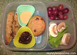 "Thanks to Gina of MoneyWiseMoms for this delicious lunch! Visit her blog to find out where to purchase the colorful silicone baking cups that make this lunch so bright and appealing  http://bit.ly/deS8lD  She writes, ""... leftover chicken tenders from dinner the night before, with honey mustard and BBQ dips, along with his fruits, veggies and dessert. I was skeptical that the dips would stay contained, especially when I saw him swinging his backpack around at his friends at the bus stop, but they did. He was thrilled with lunch and loves having alternatives to sandwiches. I love using leftovers!"" Thanks Gina!"