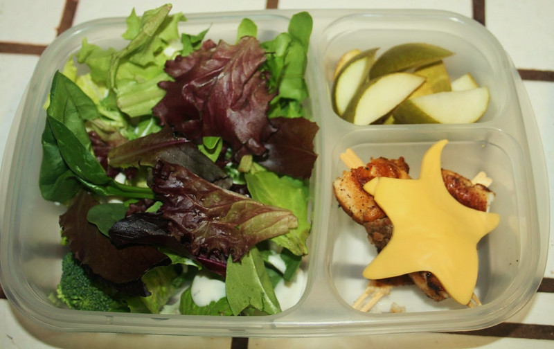 """Green salad: romaine lettuce on the bottom, broccoli and baby spring mix on the top. In between the lettuce layers is ranch dressing. The EasyLunchBoxes are not leak proof, but I think this should keep the ranch in check. It also keeps it off the lid. The upper smaller compartment holds a sliced sugar pear. The bottom compartment holds two bamboo picks with two pieces of sauteed chicken and a teriyaki chicken meatball. This is topped with a slice of american cheese cut into a star shape.""  Thanks to the delightful Kim of MamaFasha for sharing this!   http://bit.ly/9dZqeF"