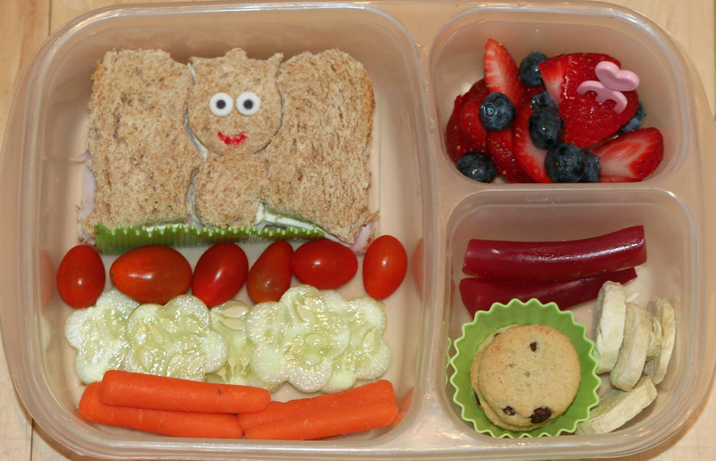 A Princess cut from a half-sandwich using Lunch Punch Sand-wishes cutters (sugar eyes and food pen drawn mouth), baby grape tomatoes, cucumber flowers, carrots, strawberries and blueberries, a couple of mini chocolate chip cookies, some freeze-dried bananas, and some Australian-cut licorice. Courtesy of Angela (Bento Madness)  http://bit.ly/acRjZu