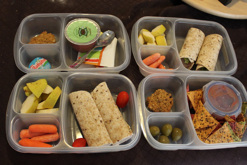"Lunch and snack for 2 kids - Lunch: Chicken roll up, pear, carrots. Snack: Sarah: Salsa and chips, olives and oatmeal chocolate chip cookie, Chloe: apple sauce, babybell and chocolate chip oatmeal cookie.  ""Sometimes your kids just don't like the same thing and sometimes it's o.k. to tailor their lunches accordingly. I wouldn't do it all the time because I'm 1) not a short order cook and 2) not that nice a Mom, but every now and again I make things a little different for the girls."" thanks to Julie of Just Eat It Already for these!    http://bit.ly/d1v245"