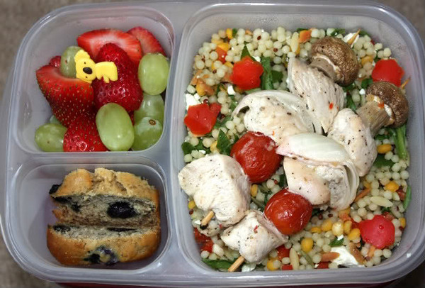 Strawberries & Grapes - Homemade blueberry Banana Bread. Chicken, tomato, onion and mushroom kabobs over a blend of Israeli style couscous, orzo, baby garbanzo Beans, red quinoa, baby spinach, red pepper and feta cheese salad. Thanks to  icreate   for this delicious lunch!