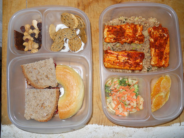 Mommy and Me Lunches! Daughter's lunch for camp: PBJ on wheat, egg bagel with cream cheese, fruit and nuts, yogurt pretzels and rice cakes. Mom's lunch for work: chipotle BBQ tofu on couscous with herbs and pimientos, broccoli salad and dried mango.Thanks to my pal Cecily for sharing this with us!