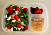 "Spinach salad with feta cheese, almonds, grape tomatoes.  Strawberries, turkey and cheese rolled in a whole wheat flour tortilla. Thanks to Amanda of lunchbox limbo  <a href=""http://bit.ly/cSYUhm"">http://bit.ly/cSYUhm</a> for this one!"