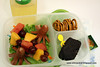 "First day of second grade lunchbox - (turkey) octodogs, fruit skewers on swizzle sticks, pretzels and a big chunk o' leftover chocolate birthday cake with a food pick. On the side are the usual apple juice/water mix and a somewhat hidden Tyrannosaurus Rex sticker. Thanks to Libby for this!  <a href=""http://bit.ly/b0WzrU"">http://bit.ly/b0WzrU</a>"